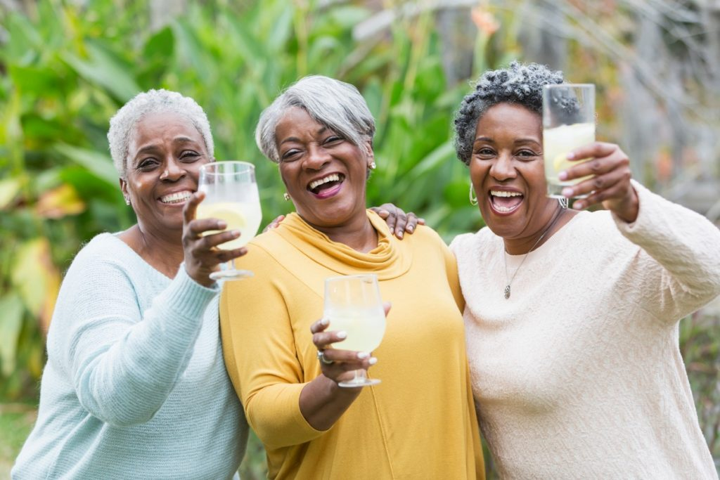 three african american ladies toasting